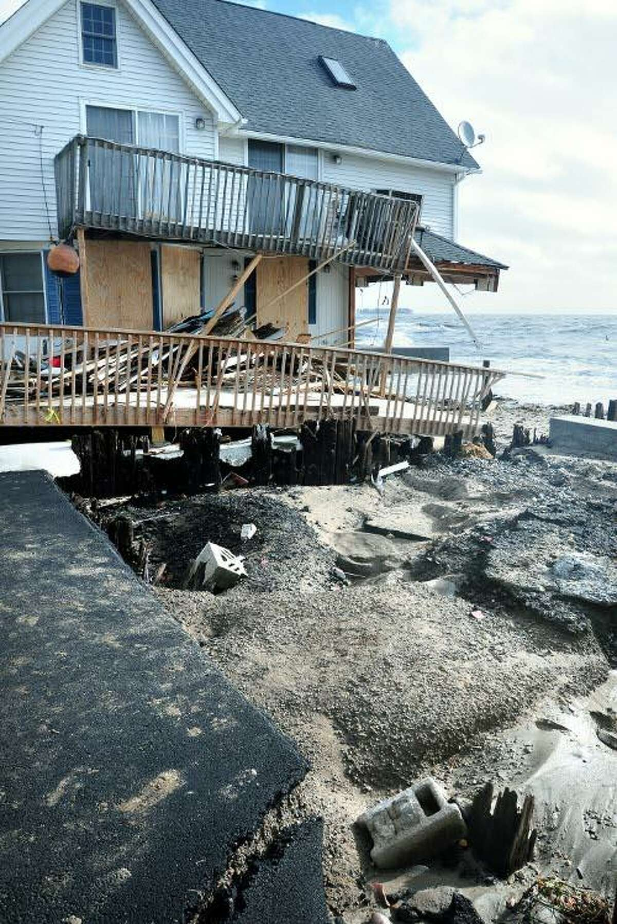 A home on Bittersweet Ave. facing the Long Island Sound in Milford photographed on 10/30/2012 was severely damaged by high tide the previous night. Photo by Arnold Gold/New Haven Register