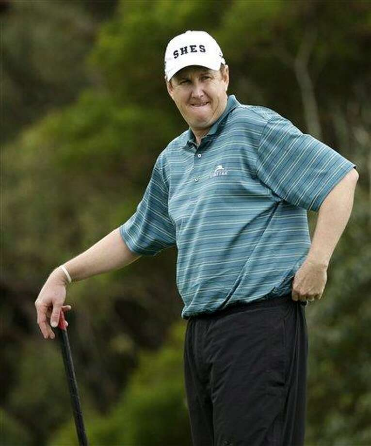 J.J. Henry waits to shoot during a pro-am round at the Tournament of Champions golf tournament on Thursday, Jan. 3, 2013, in Kapalua, Hawaii. (AP Photo/Elaine Thompson) Photo: AP / AP