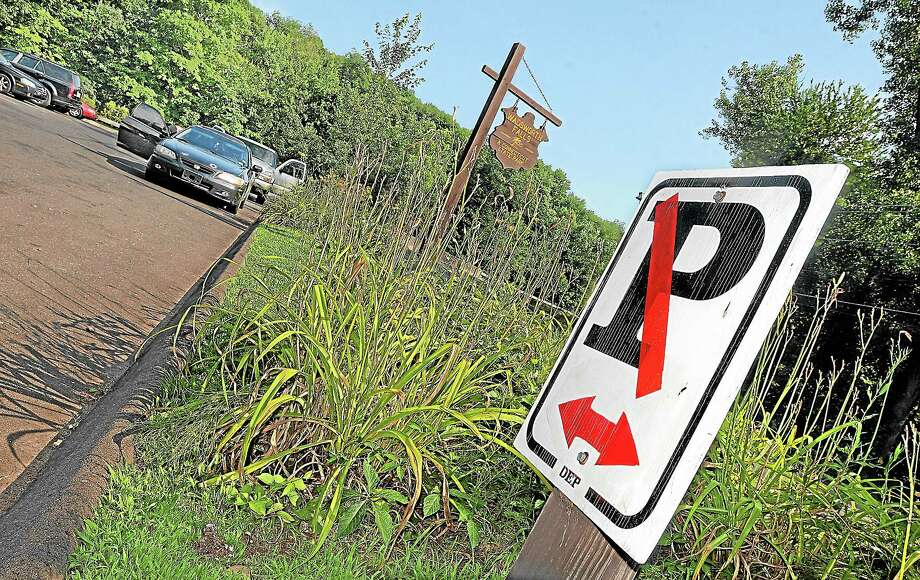 Vehicles park temporarily in a no parking zone waiting for a free parking space at Wadsworth Falls State Park on Cherry Hill Road in Middlefield this summer. Catherine Avalone — The Middletown Press Photo: Journal Register Co. / TheMiddletownPress