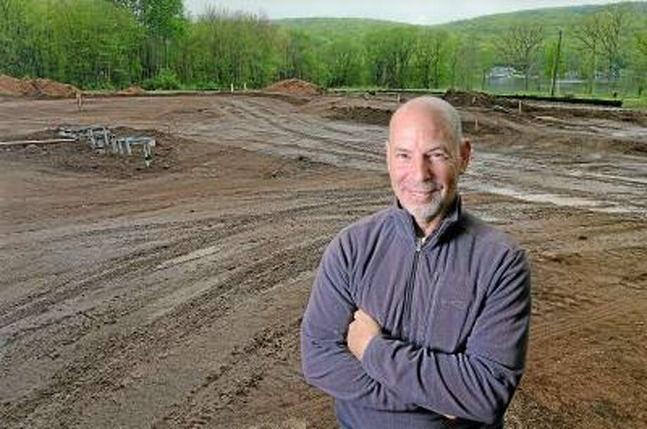 Catherine Avalone/The Middletown Press Southington developer Ray Kastner stands at Lakeview Estates, a 14 acre property formerly known as Happy Acres on Powder Hill Road in Middlefield where plans are underway to build 22 craftsman sytle homes overlooking Lake Beseck. The 55 plus community homes will range from 1,600 to 2,500 square feet starting at $385,000 and will private access to the lake. / TheMiddletownPress
