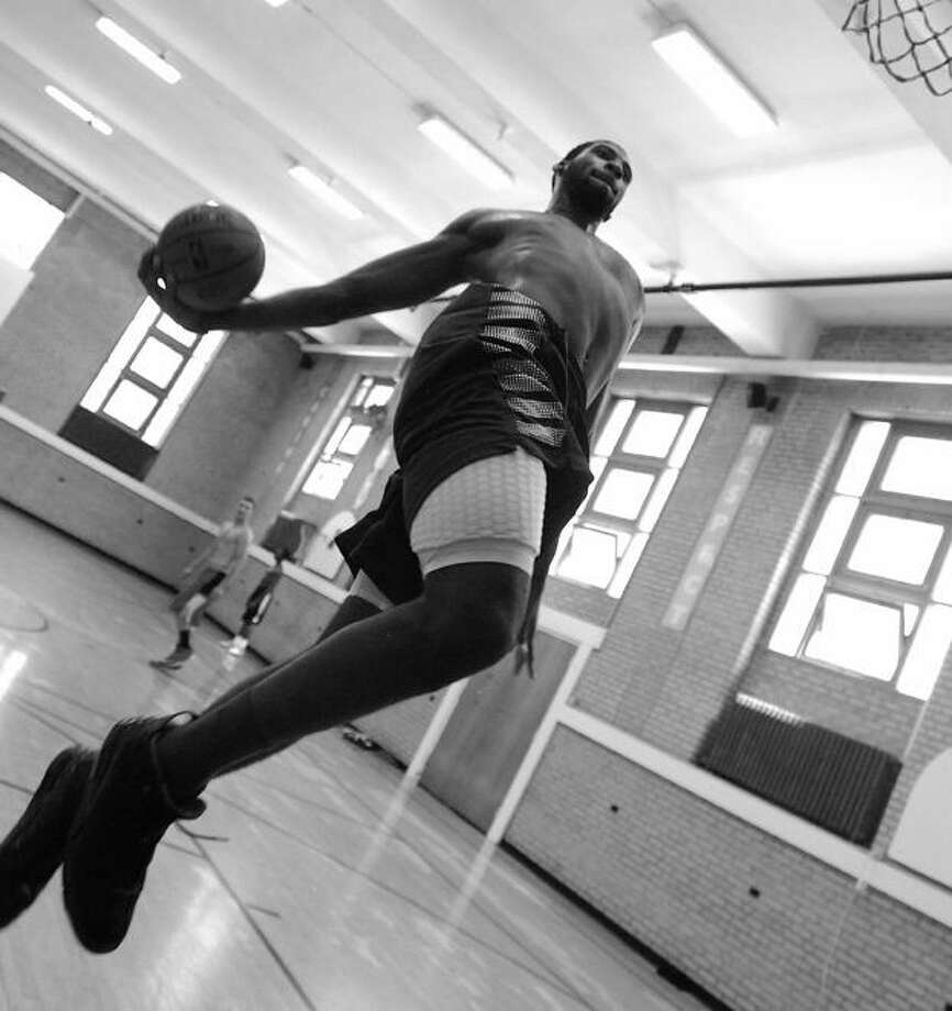 Middletown's Andre Drummond dunks at the Northern Middlesex YMCA Saturday.