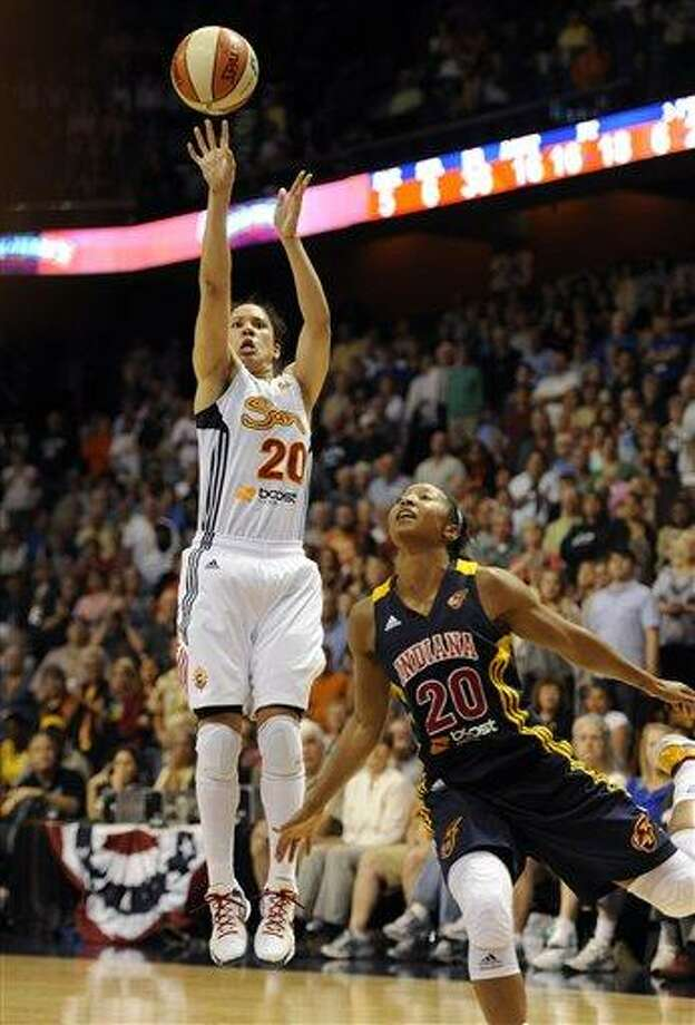 Connecticut Sun's Kara Lawson releases the game-winning shot while guarded by Indiana Fever's Briann January in overtime of a WNBA basketball game in Uncasville, Conn., Tuesday, June 19, 2012. Connecticut won 88-85. (AP Photo/Jessica Hill) Photo: AP / AP2012