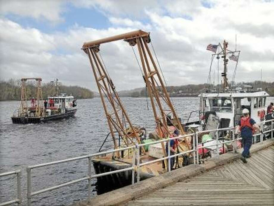 Lauren Sievert/The Middletown Press Members of the Coast Guard manning three cutters docked on the Connecticut River at Harbor Park in Middletown got their orders Tuesday morning to return to New Haven.