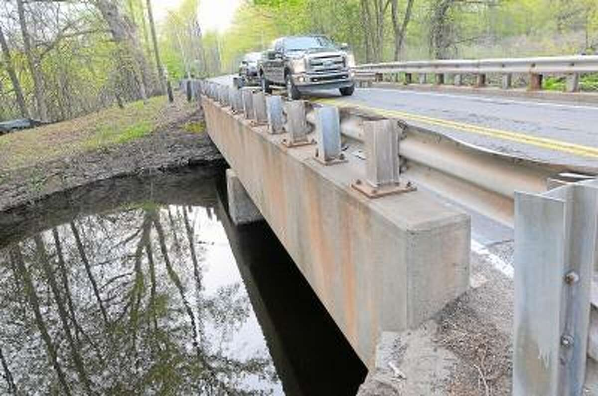 Catherine Avalone/The Middletown Press Work on the bridge on Rte. 147 between Cherry Hill Road and Lyman Road in Middlefield.