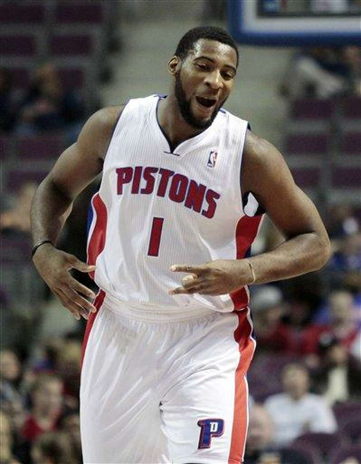 Detroit Pistons' Andre Drummond reacts after a three-point basket by teammate Jonas Jerebko during the first half of an NBA basketball game against the Orlando Magic, Tuesday, Oct. 16, 2012, in Auburn Hills, Mich. (AP Photo/Duane Burleson)
