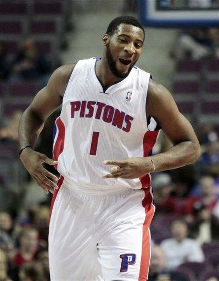 Detroit Pistons' Andre Drummond reacts after a three-point basket by teammate Jonas Jerebko during the first half of an NBA basketball game against the Orlando Magic, Tuesday, Oct. 16, 2012, in Auburn Hills, Mich. (AP Photo/Duane Burleson) Photo: AP / FR38952 AP