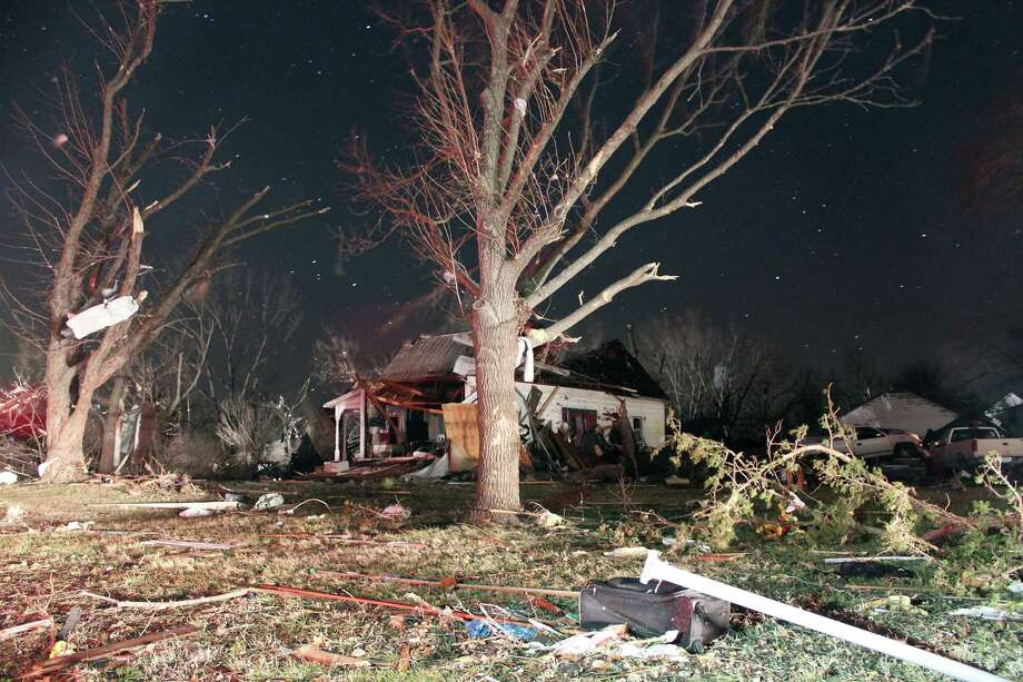 Damage is seen early Wednesday morning in the town of Harveyville in Wabaunsee County Kansas after an apparent tornado passed through the town Tuesday night. Kansas Gov. Sam Brownback declared a state of emergency late Tuesday after an apparent tornado struck Harveyville, part of a powerful storm system that pounded the state's midsection. (AP Photo/Matthew Fowler, Gazette) Photo: ASSOCIATED PRESS / AP2012