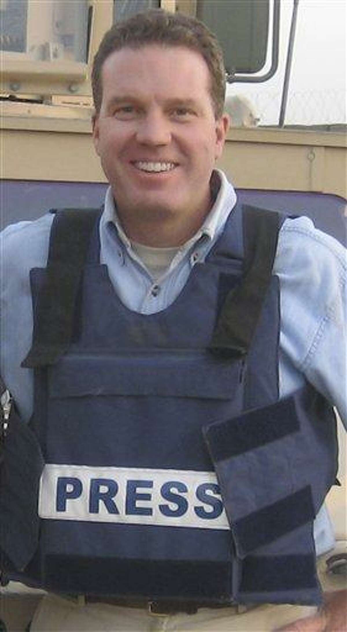 This picture shows Gregory Joseph Burke as a Fox News journalist in the U.S. base of Camp Spann in Afghanistan. Burke, 52, has agreed to become a senior communications adviser in the Vatican's secretariat of state, part of a new interface with world media. Burke would probably have to sign off on events like the Vatican bank's press conference. Associated Press