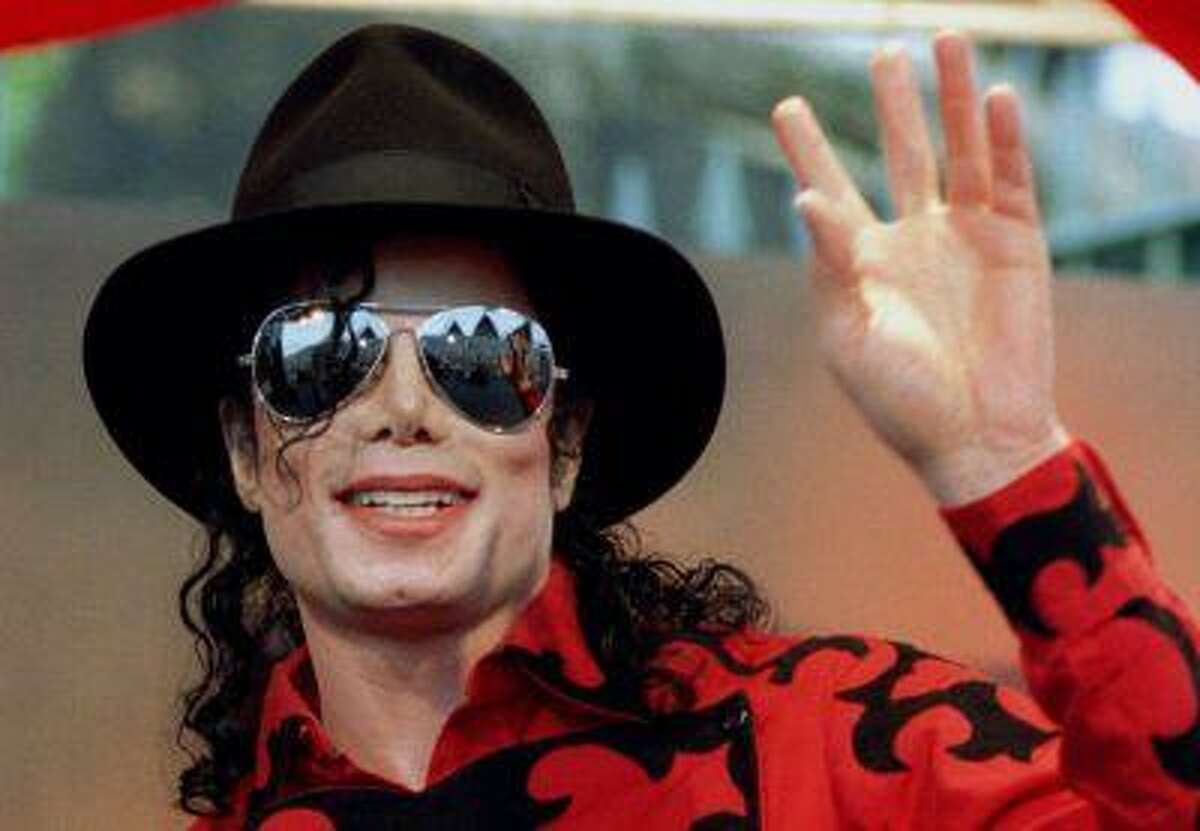 Michael Jackson waves to the crowd, numbering a few thousand, gathered in front of the Sydney Opera House.