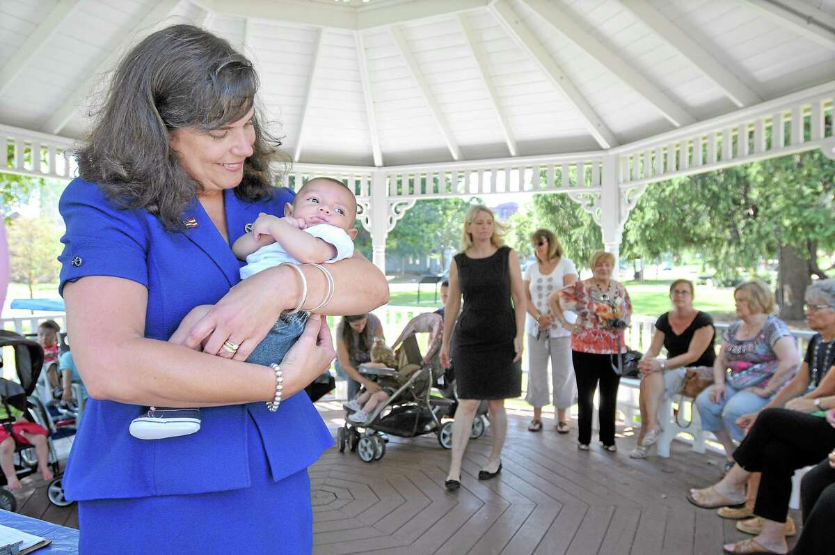 Senator Dante Bartolomeo, a mother of two sons, holds 2 month old Luke Davila during the Diaper Drive at Veterans Memorial Gazebo at Union Park on the South Green. The Diaper Bank collected 700 to 800 diapers Wednesday morning as a part of National Diaper Need Awareness Week. The Diaper Bank provides diapers to Even Start, Early Head Start and the Nurturing Family Network at Middlesex Hospital and the Family Wellness Center at the Community Health Center, all in Middletown. Catherine Avalone - The Middletown Press