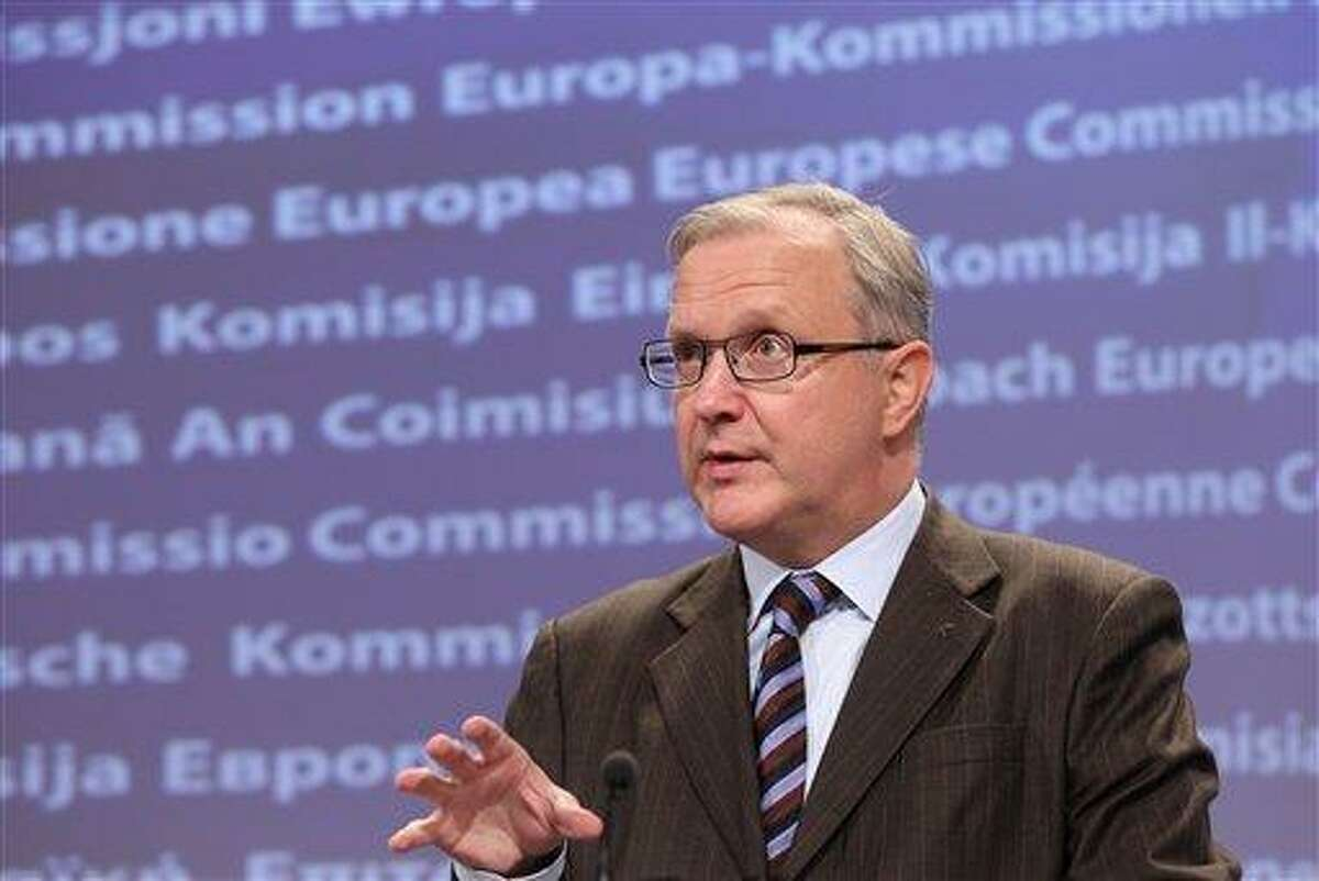 """European Commissioner for Economic and Monetary Affairs Olli Rehn addresses the media at the European Commission headquarters in Brussels Monday. The EU's top economic affairs official says the Greek parliament's approval of a new austerity package is a """"crucial step forward"""" in getting a second, euro130 billion ($171 billion) bailout. Associated Press"""