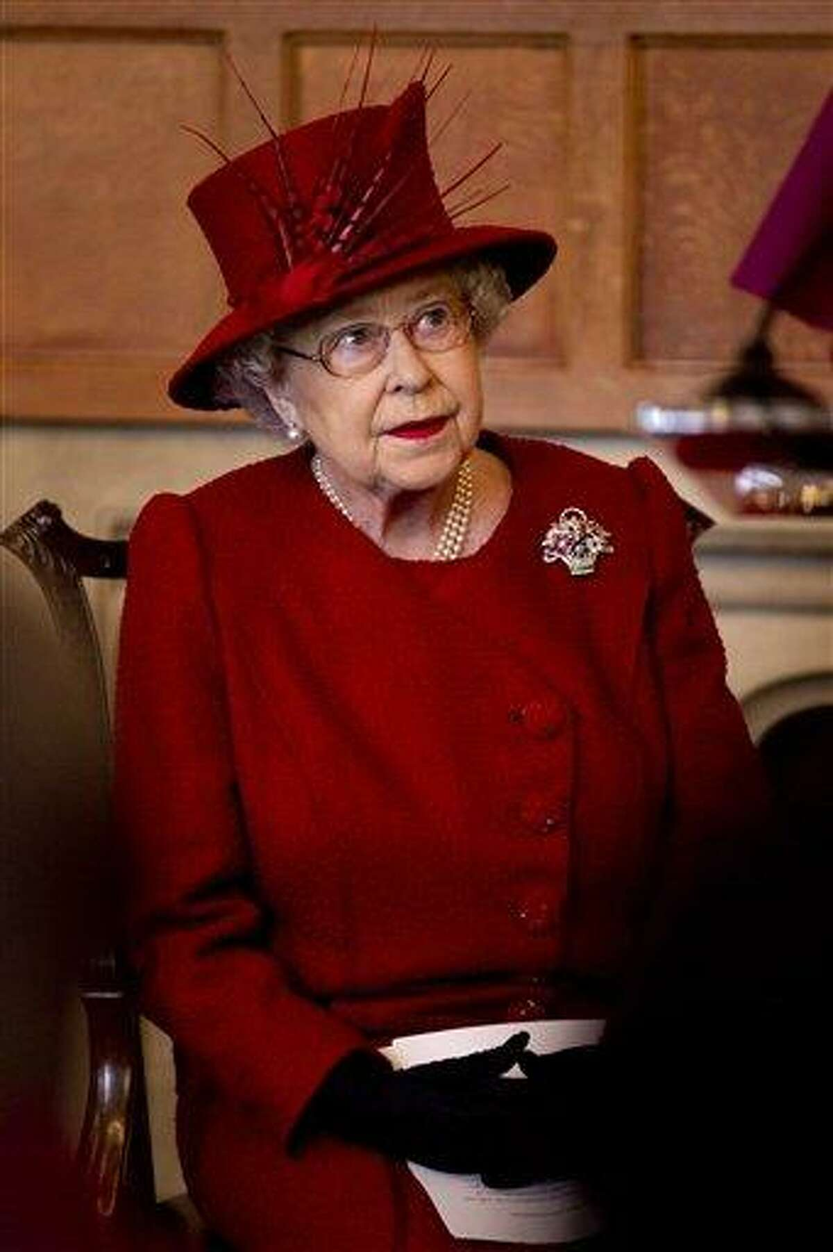 Britain's Queen Elizabeth II listens as the Archbishop of Canterbury Rowan Williams makes a speech as they attend a multi-faith reception to mark the Diamond Jubilee of the Queen's Accession at Lambeth Palace in London Wednesday. Associated Press