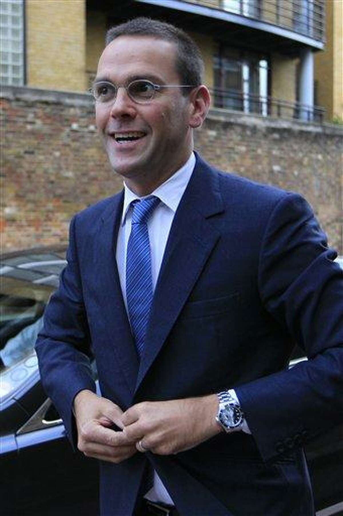 In this July 2011 file photo, chief executive of News Corporation Europe and Asia, James Murdoch arrives at News International headquarters in London. Murdoch has relinquished his position as executive chairman of News International Wednesday, its UK publishing unit. Associated Press