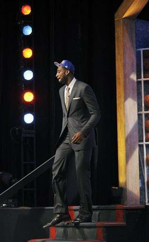 Connecticut's Andre Drummond walks from the stage as the No. 9 overall draft pick selected by the Detroit Pistons in the NBA basketball draft, Thursday, June, 28, 2012, in Newark, N.J. (AP Photo/Bill Kostroun) Photo: AP / FR51951 AP