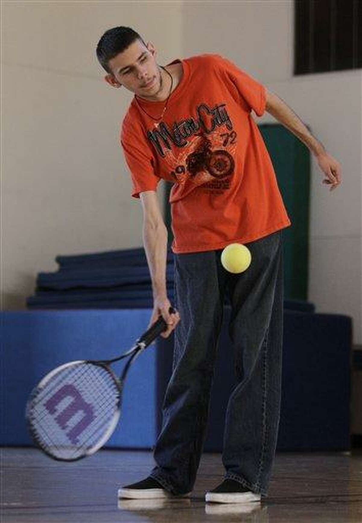 Austin Benavidez, who is blind, returns a volley using an oversized ball filled with ball bearings at the California School for the Blind in Fremont, Calif. Students at the school are learning to play tennis, and expanding the boundaries of what the blind can do while offering new insights into the human mind. They must turn their ears into eyes, listening for the ball's bounce to figure out where to swing their rackets. (AP Photo/Ben Margot)