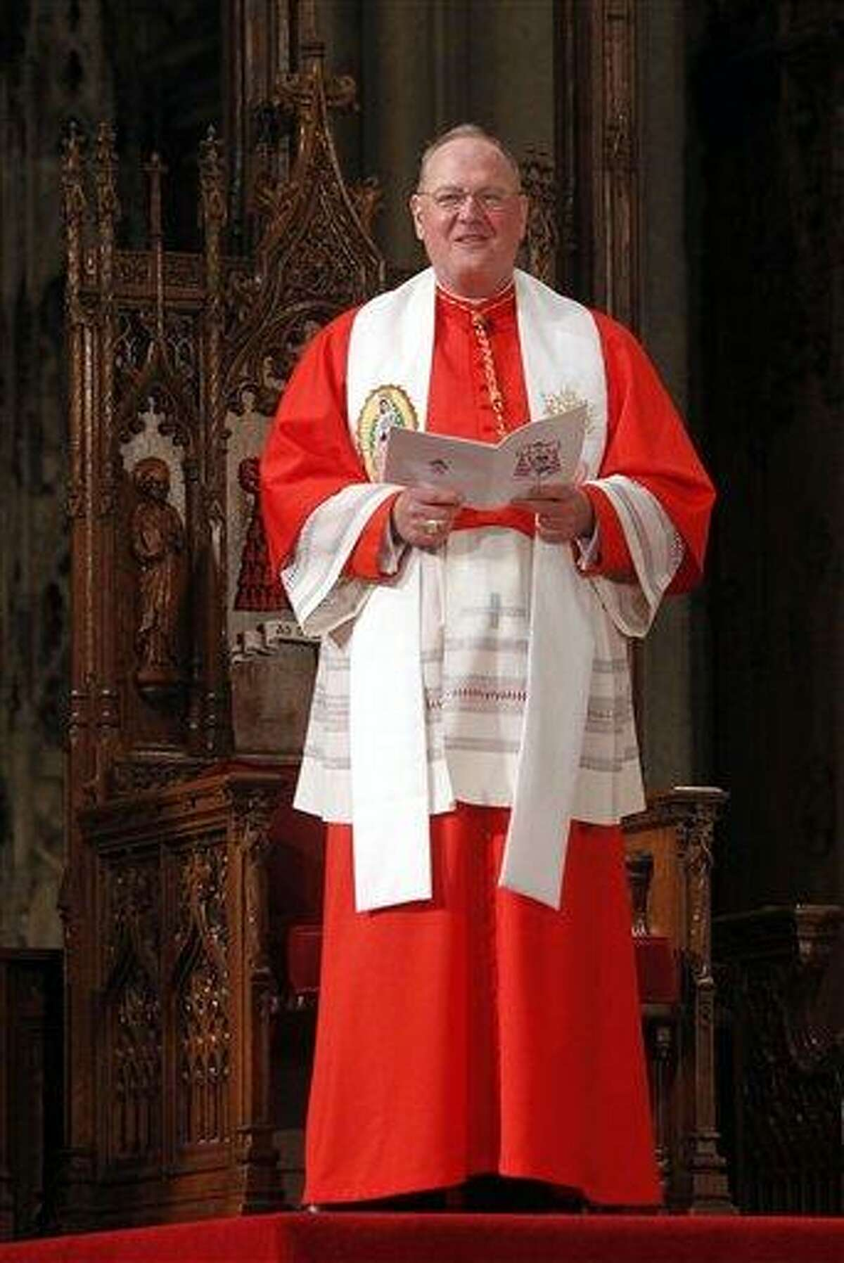Cardinal Timothy Dolan leads a morning prayer service at St. Patrick's Cathedral Saturday in New York City. Associated Press