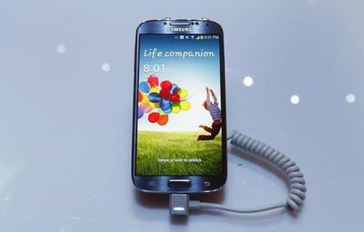 Samsung Electronics Co's latest Galaxy S4 phone is seen during its launch at the Radio City Music Hall in New York March 14, 2013.