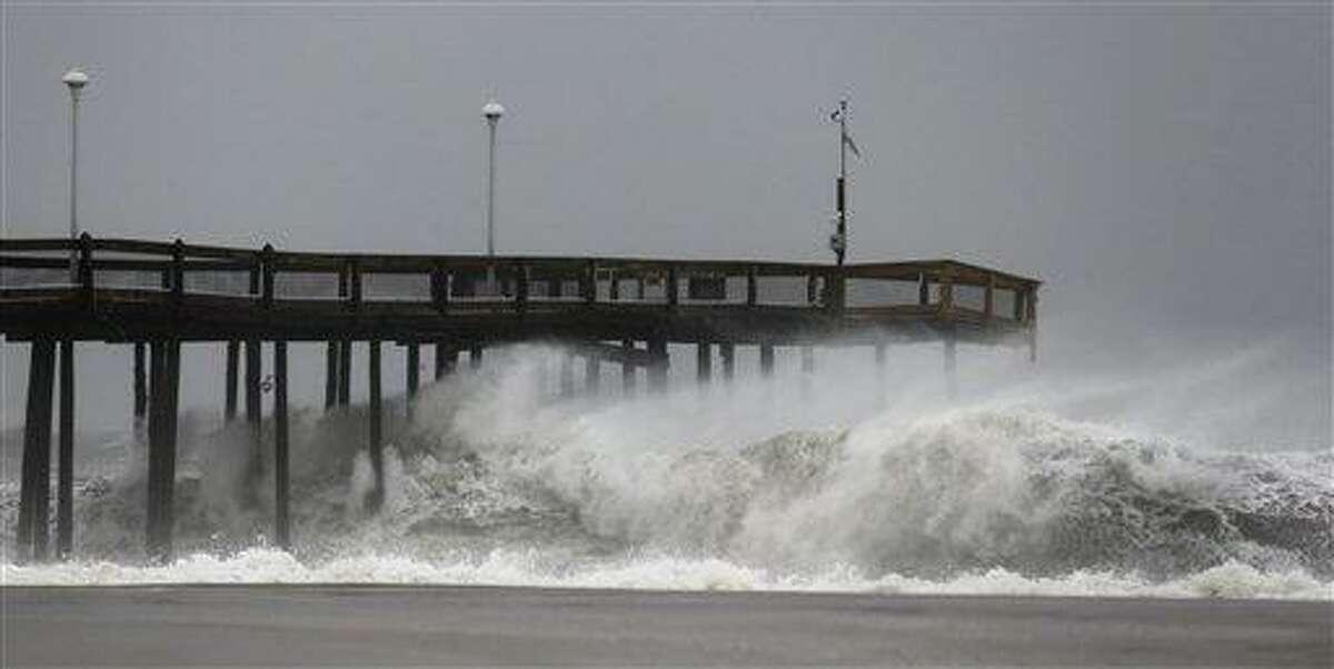 Waves crash into the Ocean City Fishing Pier as Hurricane Sandy bore down on the East Coast. AP Photo/Alex Brandon