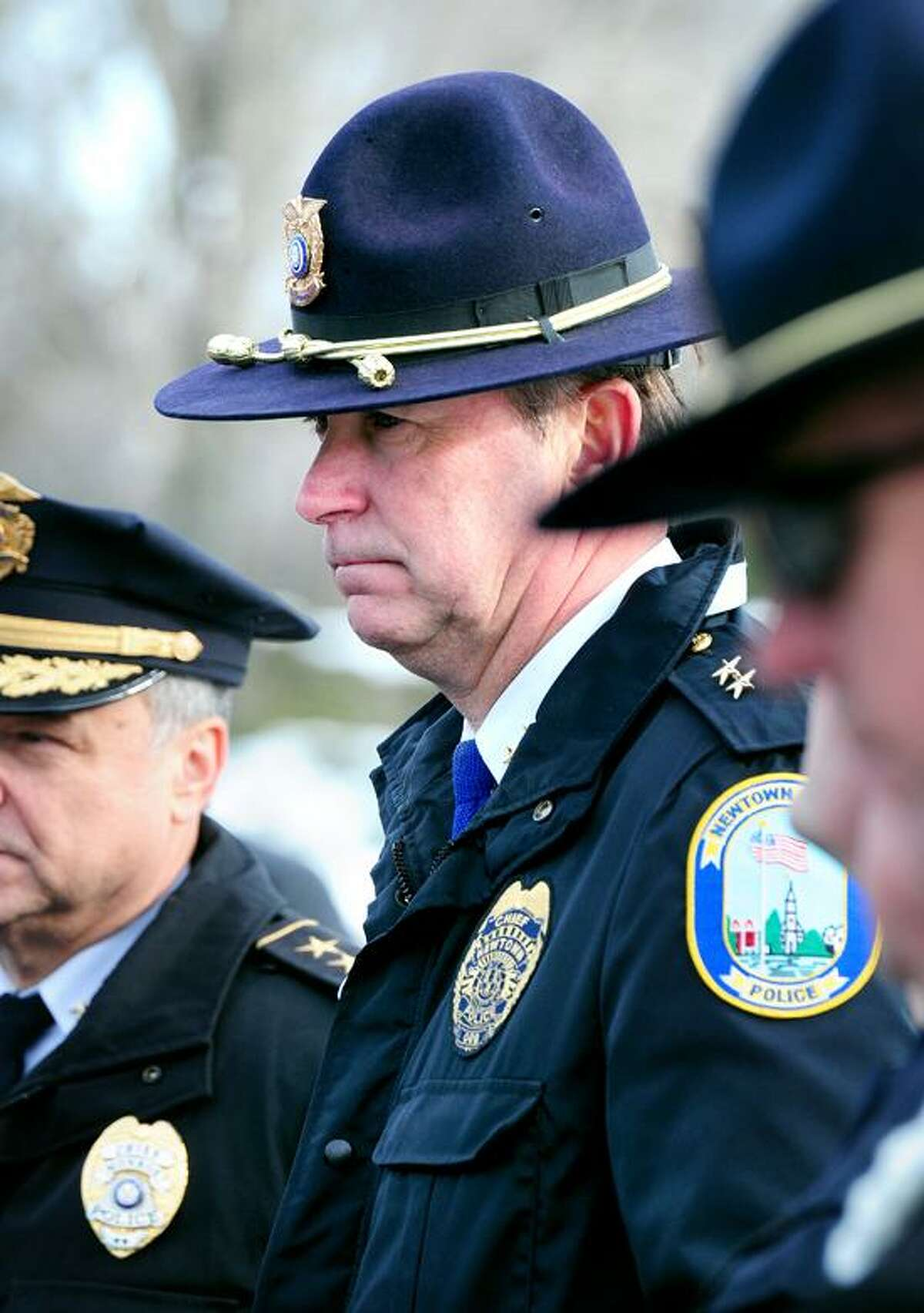 Newtown Police Chief Michael Kehoe (center) listens to Newtown Superintendent of Schools Janet Robinson speak at a press at Wolfe Park in Monroe about the new Sandy Hook Elementary School in Monroe on 1/2/2013.Photo by Arnold Gold/New Haven Register