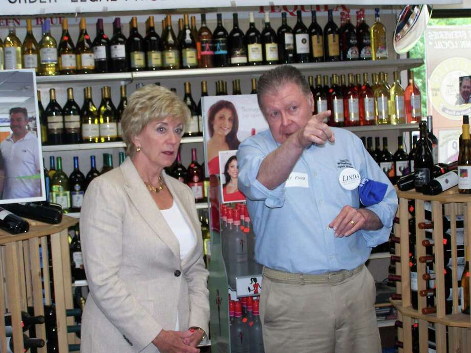 U.S. Senate candidate Linda McMahon speaks to Jay Polke, a local Cromwell businessman, about the state of business in Connecticut on Tuesday.