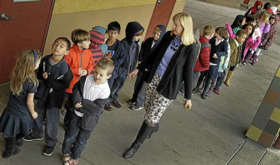 In this July 24, 2013 file photo, first grade teacher Lynda Jensen walks with her class of 30 children at Willow Glenn Elementary School in San Jose, Calif. Photo: Ben Margot — The Associated Press File Photo  / AP