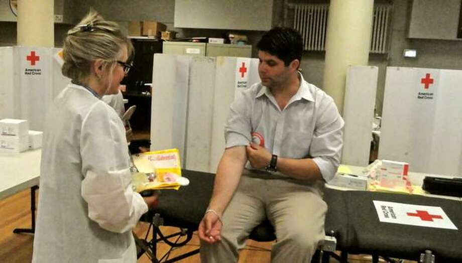 Middletown Mayor Dan Drew donates blood. Photo courtesy Cassandra Day, Middletown Patch