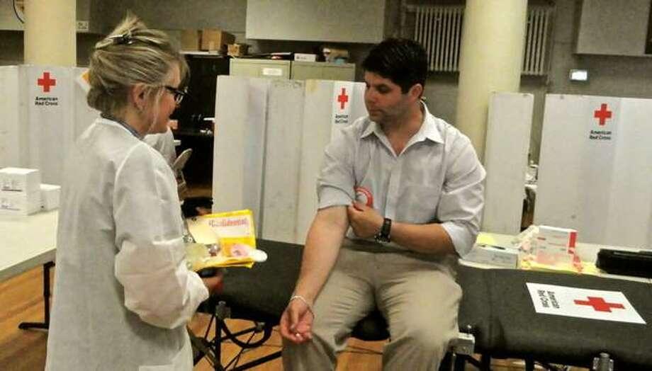 Middletown Mayor Dan Drew donates blood. Photo courtesy Cassandra Day, Middletown Patch