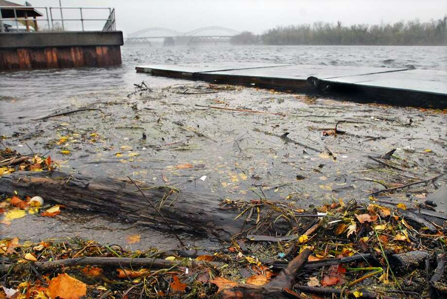 Catherine Avalone/The Middletown PressWashed up debris at the boat launch area at Harbor Park, but no flooding as of Monday afternoon.