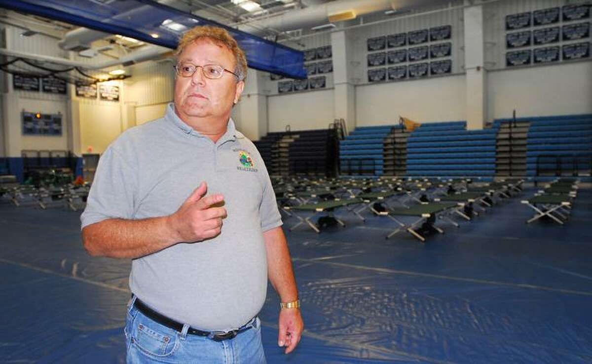 Catherine Avalone/The Middletown PressLuis Carta, public information officer for the city shelter at Middletown High School said as of Monday afternoon there are 100 cots for residents and there are medical on site.