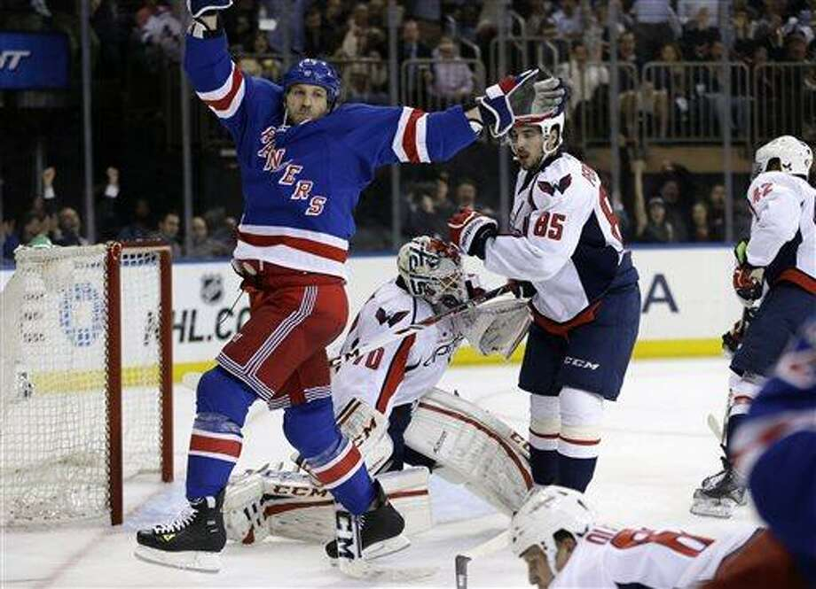 New York Rangers right wing Ryane Clowe (29) celebrates a goal scored by left wing Carl Hagelin in the second period of Game 4 of their first-round NHL hockey Stanley Cup playoff series against the Washington Capitals in New York, Wednesday, May 8, 2013.  (AP Photo/Kathy Willens) Photo: AP / AP