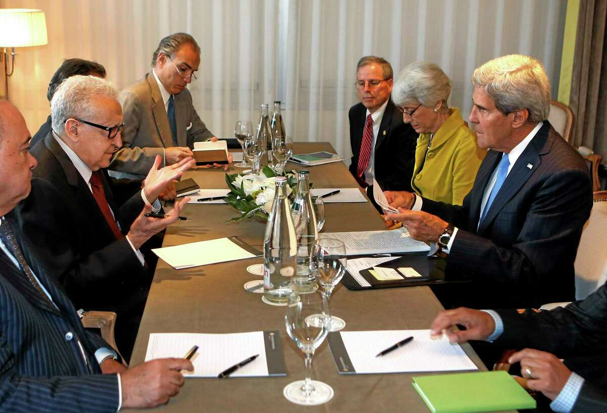 U.S. Secretary of State John Kerry, right, talks with the U.N. Special Representative for Syria Lakhdar Brahimi, second left, in Geneva, Switzerland Thursday Sept. 12, 2013. Kerry flew into Geneva on Thursday to hear Russia's plans to disarm Syria of its chemical weapons and avert U.S.-led military strikes.