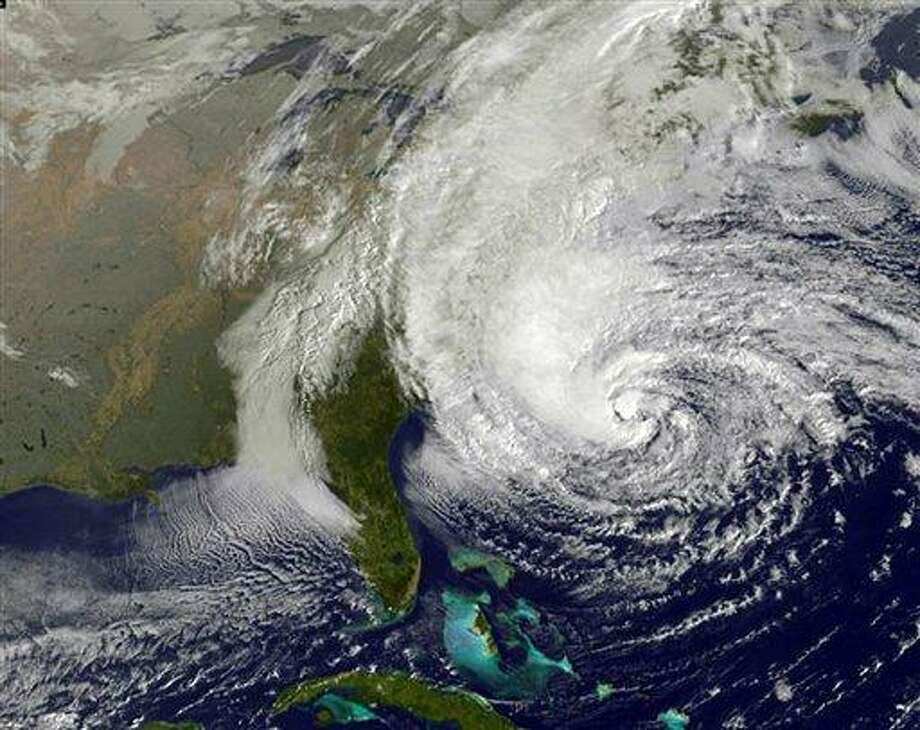 This NOAA satellite image taken Sunday shows Hurricane Sandy off the Mid Atlantic coastline moving toward the north with maximum sustained winds of 75 mph. Tens of thousands of people were ordered to evacuate coastal areas Sunday as big cities and small towns across the U.S. Northeast braced for the onslaught of a superstorm threatening some 60 million people along the most heavily populated corridor in the nation. (AP Photo/Weather Underground) Photo: AP / Weather Underground