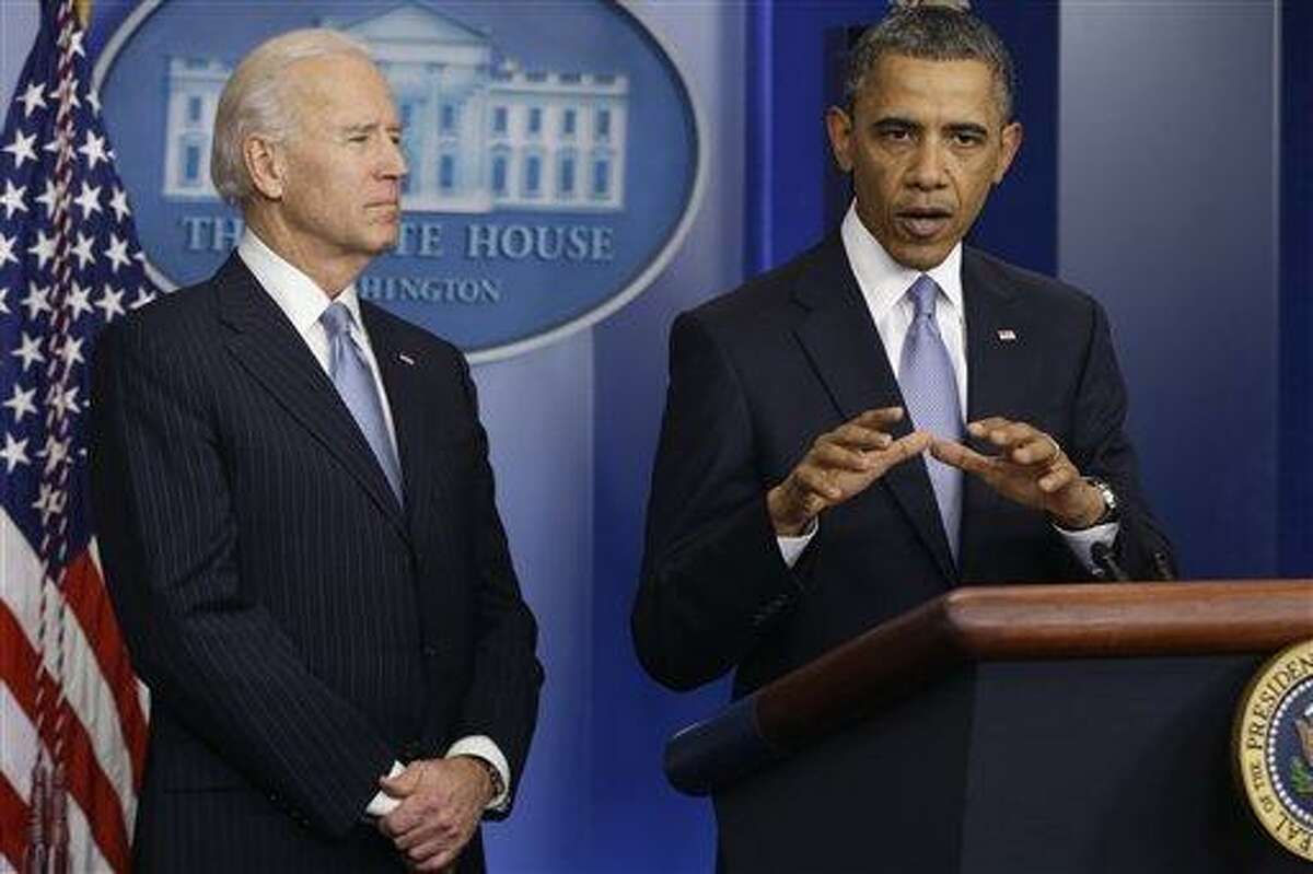 President Barack Obama and Vice President Joe Biden make a statement Jan. 1 regarding the passage of the fiscal cliff bill in the Brady Press Briefing Room at the White House in Washington. Associated Press