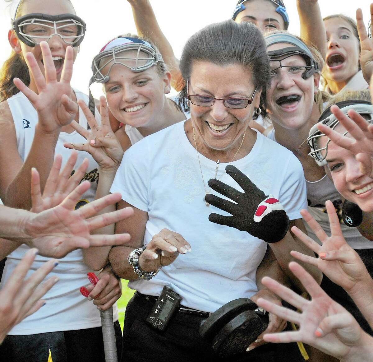 Haddam-Killingworth field hockey team surrounds head coach Patsy Kamercia following her 400th career win. H-K defeated Canton 4-2. Catherine Avalone - The Middletown Press