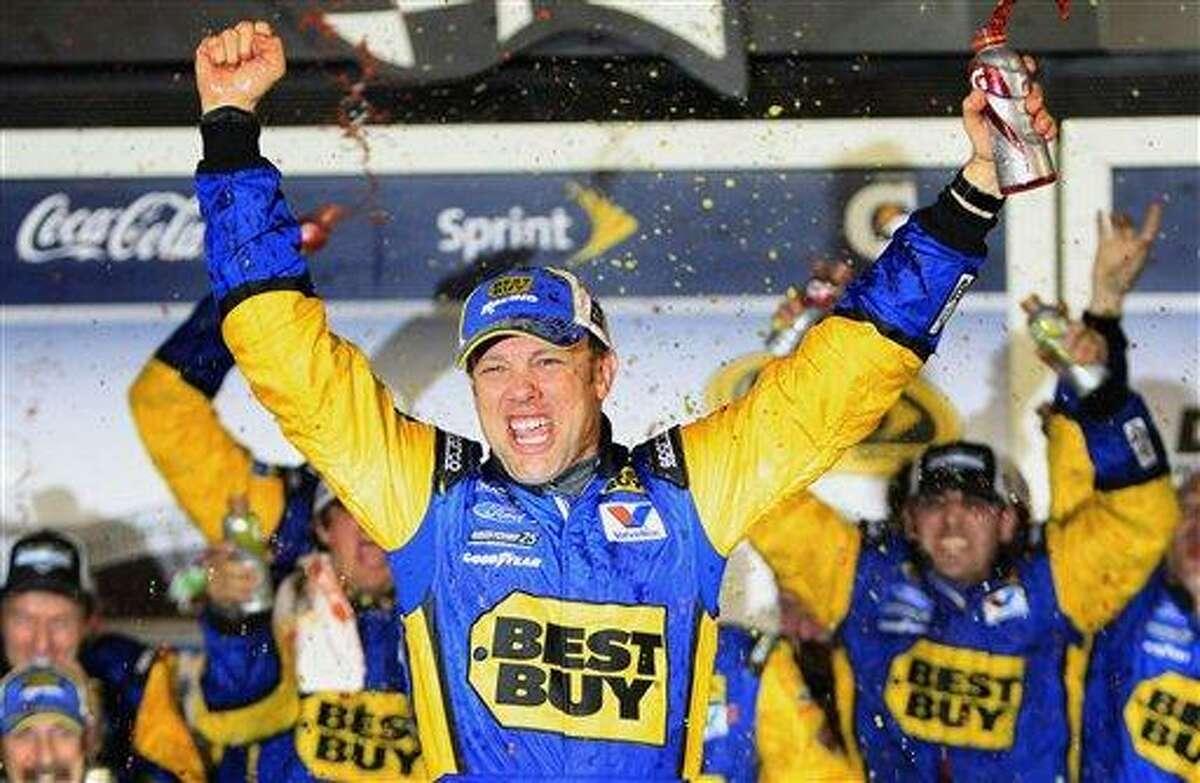 Matt Kenseth celebrates after winning the NASCAR Daytona 500 Sprint Cup series auto race at Daytona International Speedway in Daytona Beach, Fla., early Tuesday, Feb. 28, 2012. (AP Photo/John Raoux)