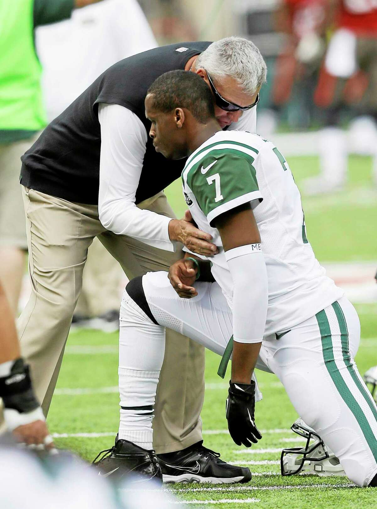 New York Jets coach Rex Ryan talks to quarterback Geno Smith before their game against the Tampa Bay Buccaneers Sunday in East Rutherford, N.J.