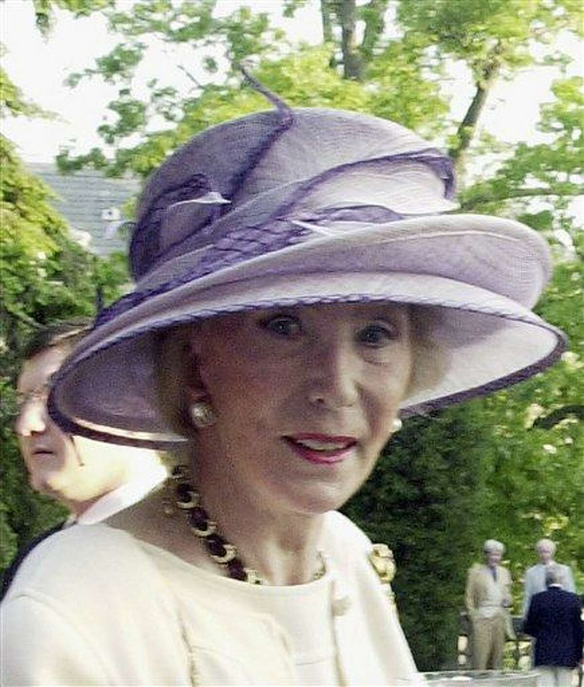This 2004 photo shows German socialite Viola Drath during the annual Woodrow Wilson home garden party and hat contest in Washington. A murder case involving a 91-year-old Washington socialite and her much-younger husband has taken a series of bizarre turns. Associated Press