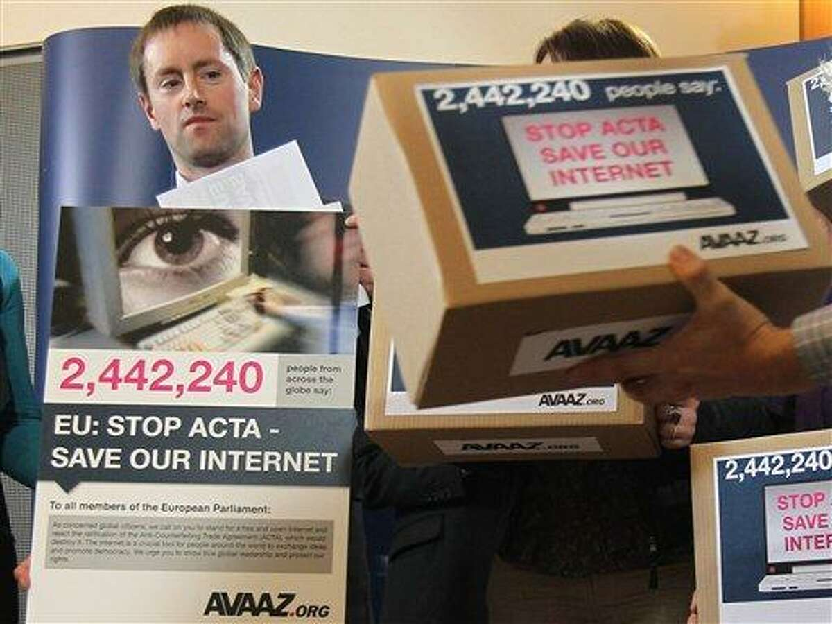 Avaaz's campaign director Alex Wilks talks to the media as he hands a petition against the Anti-Counterfeiting Trade Agreement (ACTA) to members of the European Parliament, at the European Parliament in Brussels, Tuesday. Associated Press