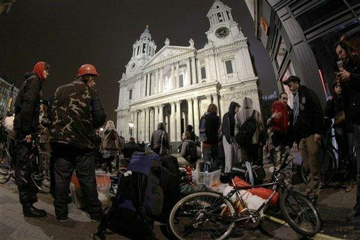 """Taken with a fisheye lens, this photo shows """"Occupy"""" London protesters with their belongings gathering across from St Paul's Cathedral in London after bailiffs moved in to remove tents from the London camp Tuesday. Associated Press"""