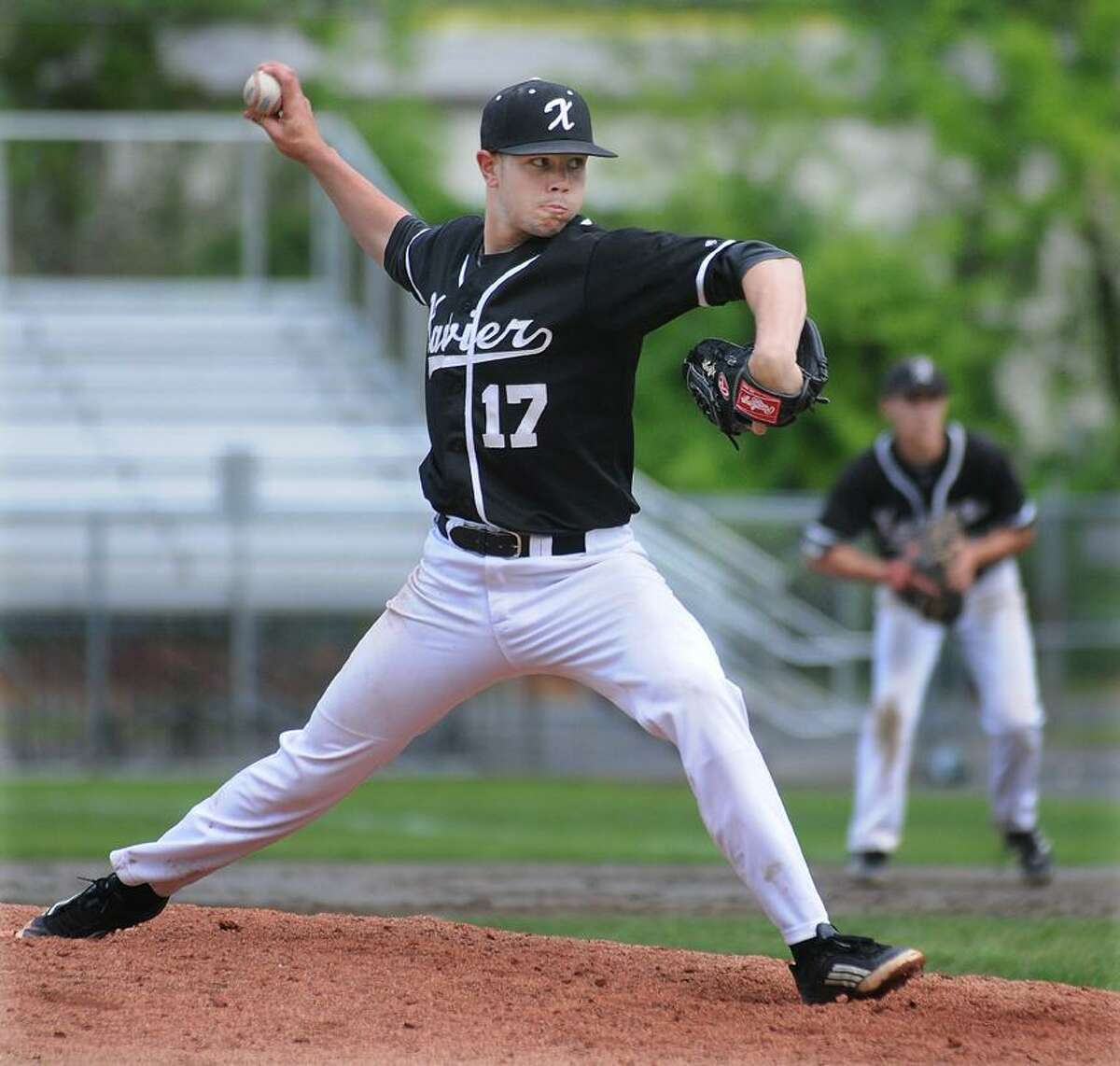 Catherine Avalone/The Middletown PressXavier senior pitcher Benjamin Criscuolo on the mound at Pomfret Stadium at Palmer Field delivers a 8-1 win for the Falcons over Hamden Thursday afternoon in Middletown.