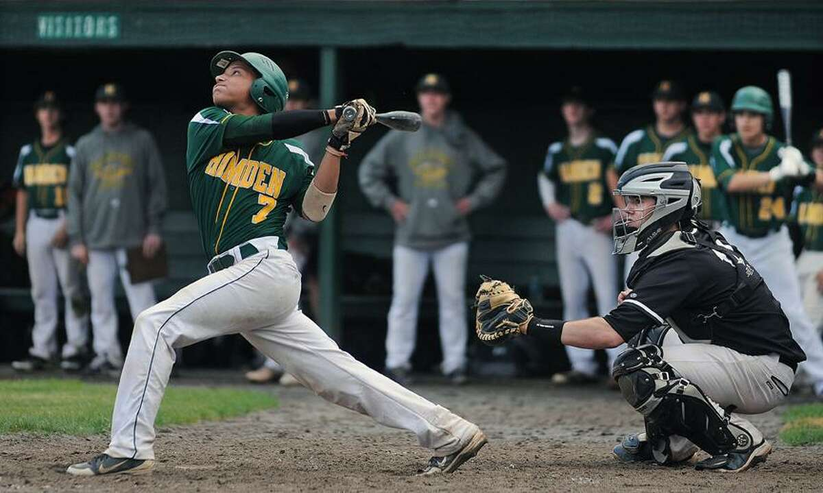 Catherine Avalone/The Middletown PressXavier junior catcher Chris Cardi behind the plate as Hamden sophomore catcher Exavier Santiago looks up as he hits a pop up out to Xavier pitcher Ben Criscuolo in the sixth inning at Pomfret Stadium at Palmer Field during an 8-1 win for the Falcons over Hamden Thursday afternoon in Middletown.