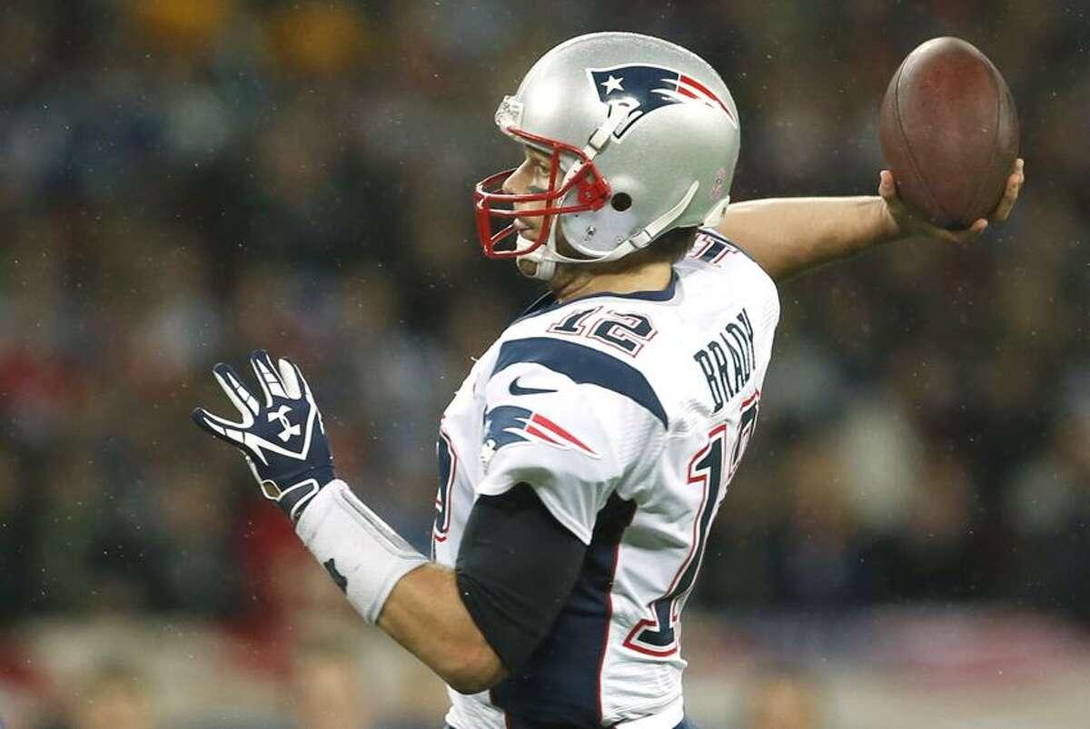 New England Patriots quarterback Tom Brady, in action during the first half of a NFL football game at Wembley Stadium, London, Sunday, Oct. 28, 2012. (AP Photo/Matt Dunham)