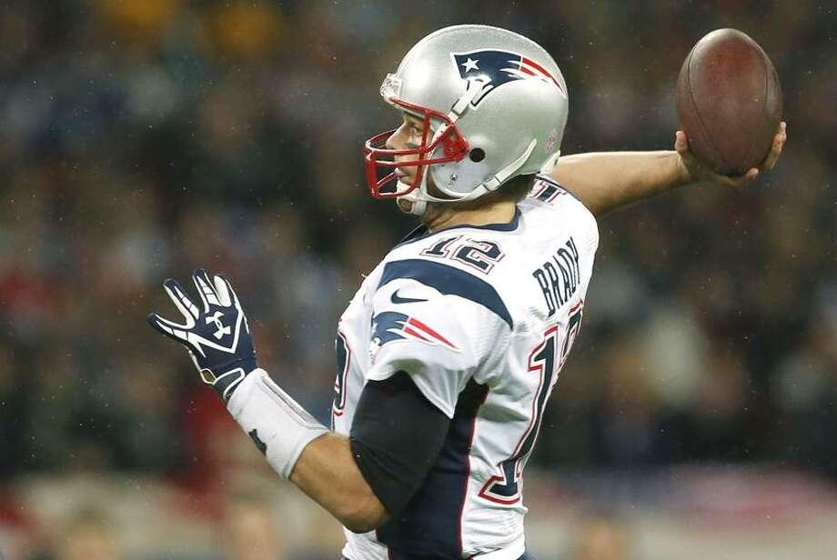 New England Patriots quarterback Tom Brady, in action during the first half of a NFL football game at Wembley Stadium, London, Sunday, Oct. 28, 2012. (AP Photo/Matt Dunham) Photo: AP / AP2012
