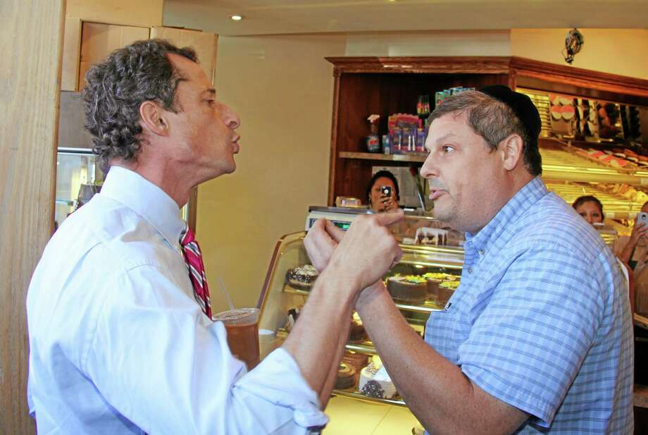 Anthony Weiner, left, who is seeking the Democratic nomination to run for the New York City Mayor's Office, has a heated argument with Shaul Kessler at Weiss Bakery in the Boro Park neighborhood in the Brooklyn borough of New York, Wednesday, Sept. 4, 2013. The altercation was captured on video and is circulating widely over the Internet. Weiner's support as a Democratic candidate for mayor collapsed amid a new sexting scandal in June, 2013 and is currently polling fourth among the candidates at 7 percent. (AP Photo/Shimon Gifter) Photo: AP / AP
