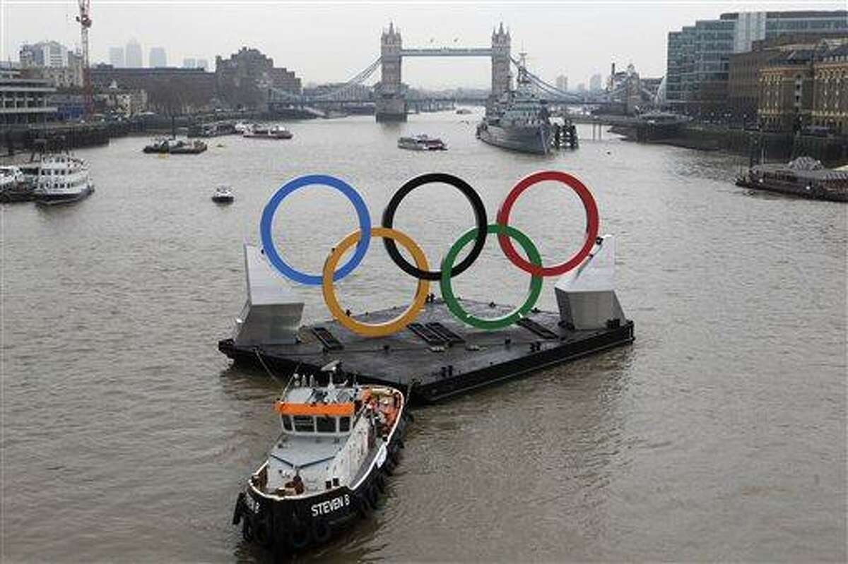 Backdropped by the historic Tower Bridge, giant Olympic rings float on the River Thames in London in the run-up for the games. Associated Press