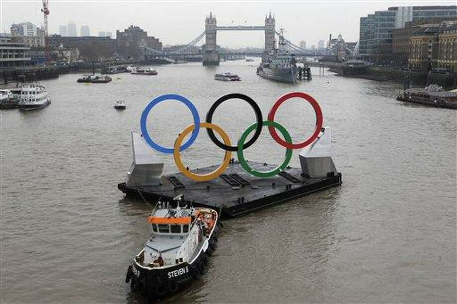 Backdropped by the historic Tower Bridge, giant Olympic rings float on the River Thames in London in the run-up for the games. Associated Press Photo: AP / Copyright 2012 The Associated Press. All rights reserved. This material may not be published, broadcast, rewritten or redistributed.