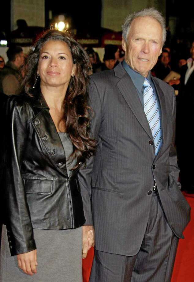 FILE - U.S Director Clint Eastwood, right, arrives with his wife, Dina on the red carpet for the UK premiere of Invictus at London's Leicester Square, in this Jan. 31, 2010 file photo. Eastwood's second wife has filed for legal separation from the actor and director. Dina Eastwood's petition filed in Monterey County Superior Court on Monday Sept. 9, 2013 seeks spousal support and physical custody of the couple's 16-year-old daughter, Morgan.(AP Photo/Joel Ryan, File) Photo: AP / AP