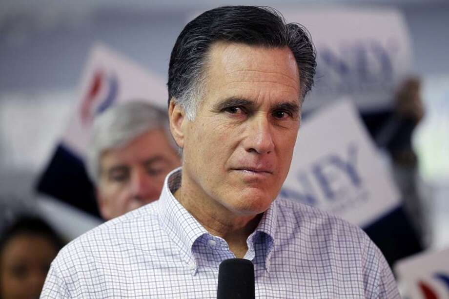 Republican presidential candidate, former Massachusetts Gov. Mitt Romney, listens to a question from a reporter as he visits a campaign call center in Livonia, Mich., Tuesday.  Associated Press Photo: AP / AP2012