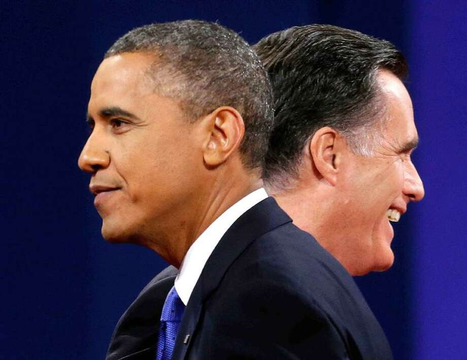 Republican presidential candidate, former Massachusetts Gov. Mitt Romney and President Barack Obama walk past each other on stage at the end of the thid debate. AP Photo/Pablo Martinez Monsivais Photo: AP / AP2012