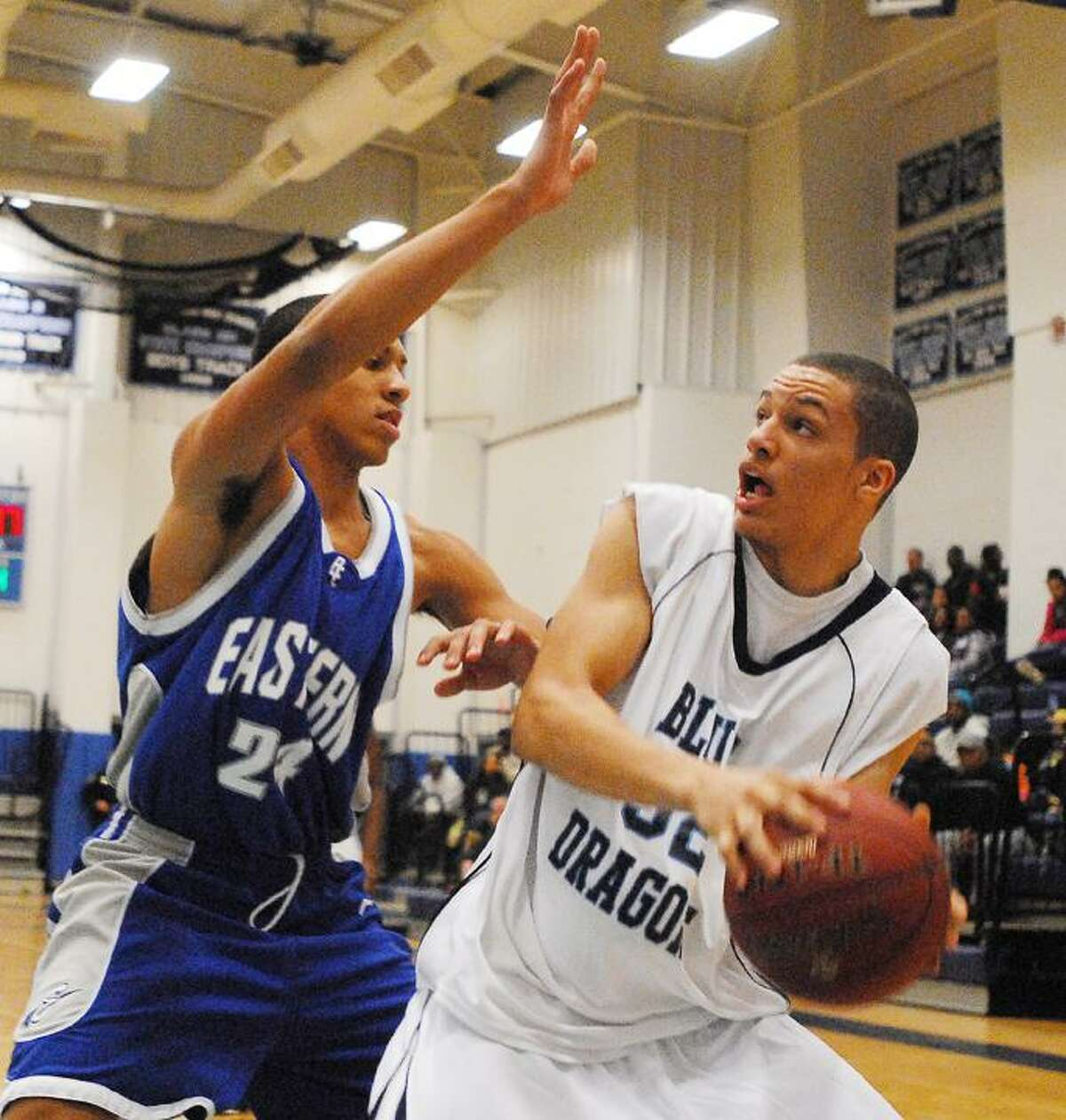 Catherine Avalone/The Middletown PressMiddletown's Brandon Simmons looks to make a move against Bristol Eastern's Kevin Love in Monday night's game in Middletown. The Blue Dragons defeated Bristol Eastern 70-46.